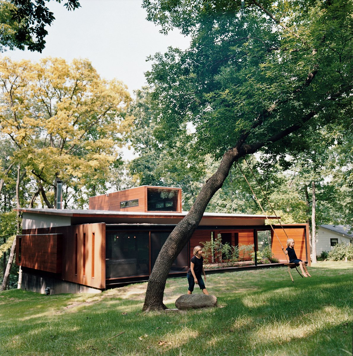 Maintaining a connection to their wooded backyard was an important consideration for the Edstorms. The back wall is designed to let in as much light and air as possible. Read more about this spacious renovation here.  Striking Designs in Wisconsin by William Lamb