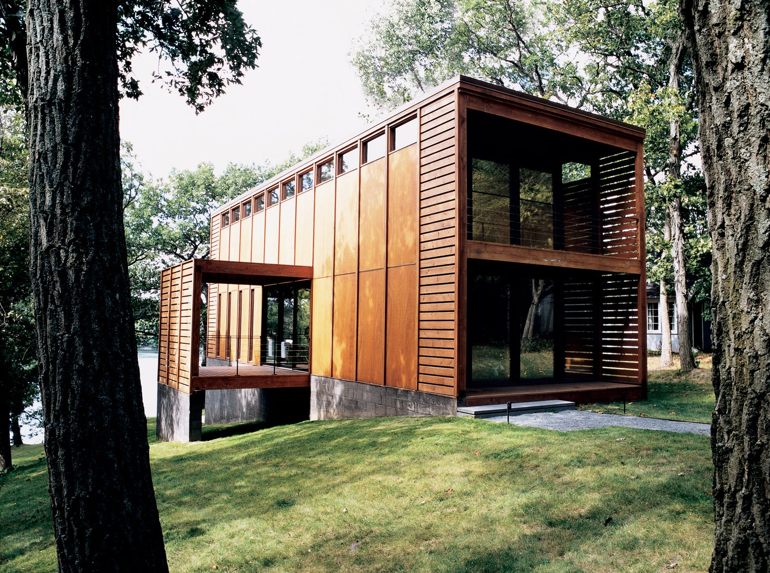 On the shores of Moose Lake, Wisconsin, the inspiration for Roger Scommegna's Aperture House came from the $9.99 bottles of wine produced at his Signal Ridge Vineyard. Tagged: Exterior and House.  Striking Designs in Wisconsin by William Lamb from Four Walls and a Screw-Top