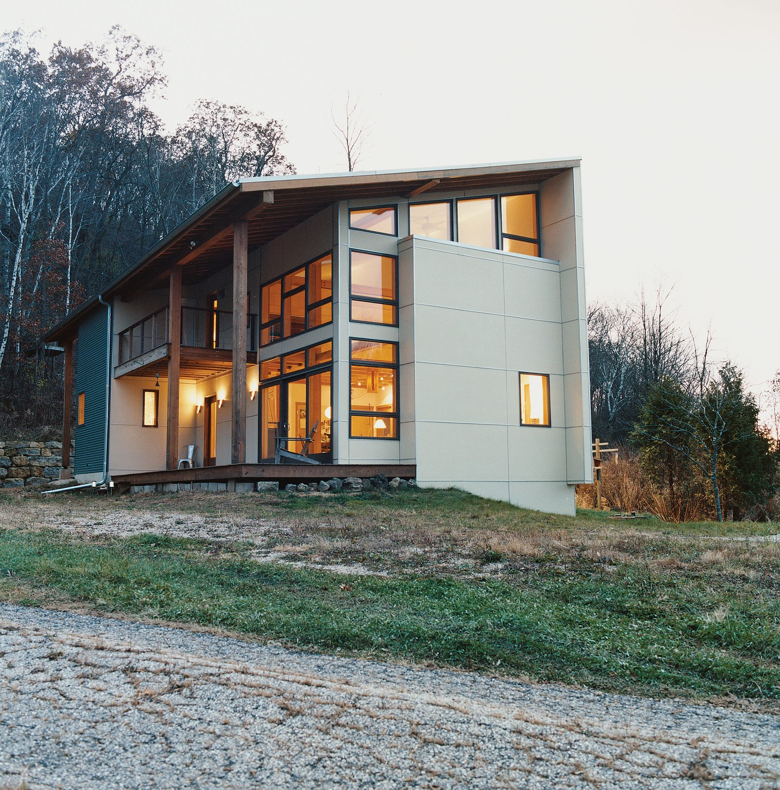 The home is clad in galvanized corrugated metal.  Striking Designs in Wisconsin by William Lamb from Labor of Loved Ones
