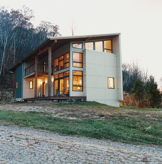 The home is clad in galvanized corrugated metal.