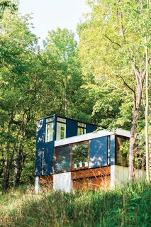 101 Best Modern Cabins - Photo 6 of 101 - Set in the lush Wisconsin forest, this neatly stacked cabin was built vertically in order to minimize the amount of grading and landscaping necessary for construction. Photo by: Narayan Mahon