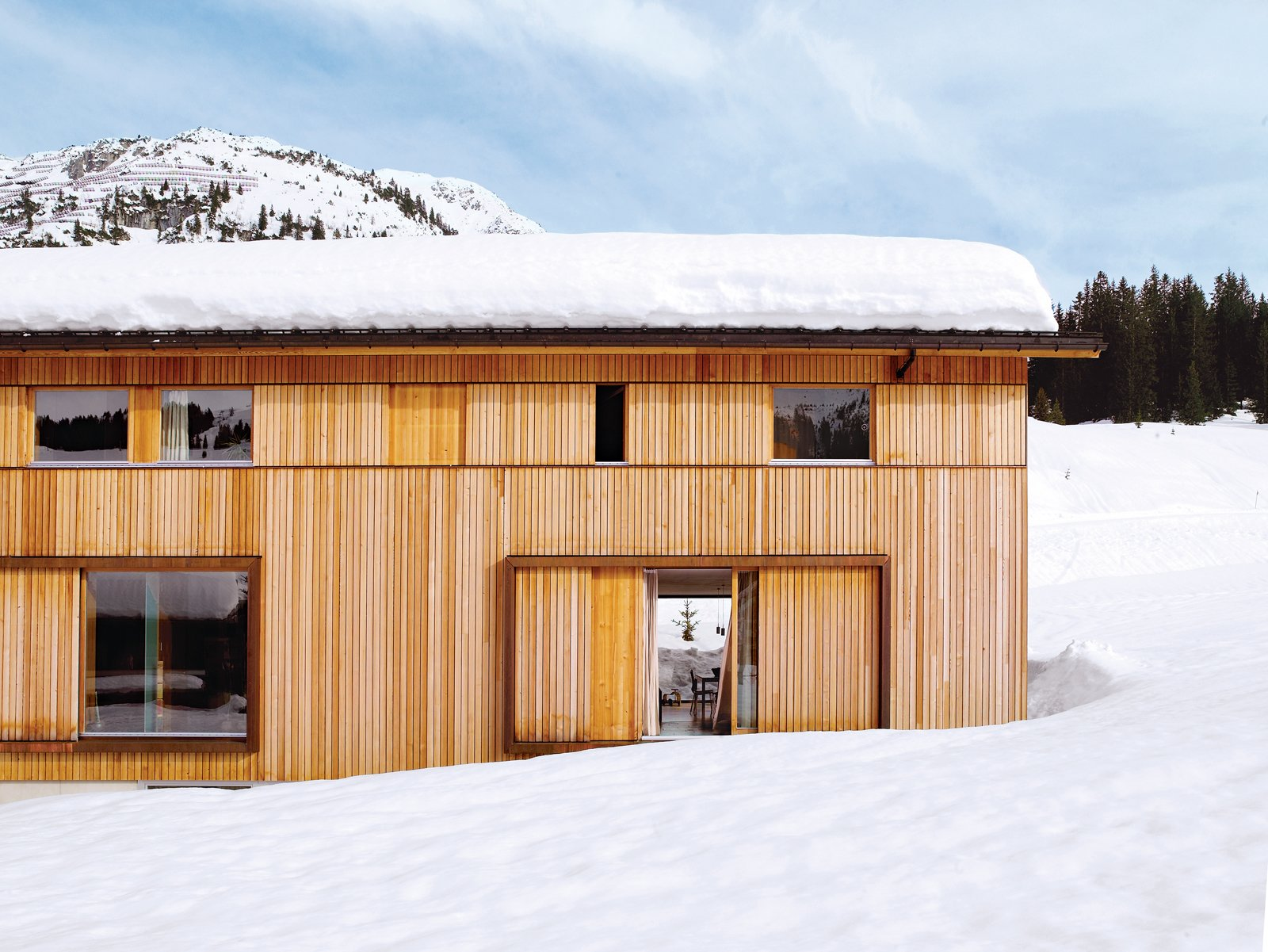 The house, which is gently pushed into the hillside, has a large basement holding a garage, ski room, storage areas, and utility spaces as well as the entrance hall.  Photo 2 of 8 in Snow Proofed Hillside Family Home in Austria