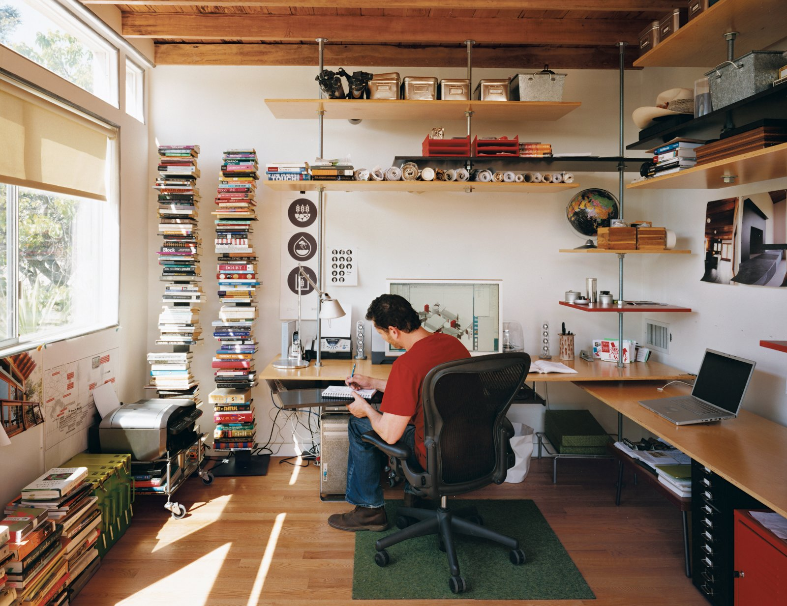 A preoccupation for Levine was saving space and money; he and his team used threaded steel rods and birch veneer plywood to construct the shelving in his office at the rear of the house.  Photo 9 of 10 in Casa Study House #1