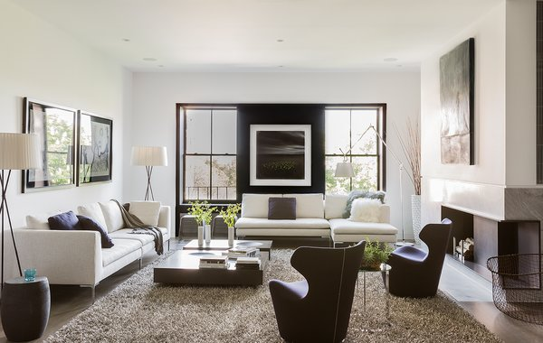 Since a sophisticated, modern look was imperative to the architectural design, the same was expected of the furnishings. A B&B Italia Charles sofa, chaise lounge, and Piccola Papilio chairs fill the living room. Trípode Floor Lamps by Santa & Cole frame the sofa. Photo  of Back Bay modern home