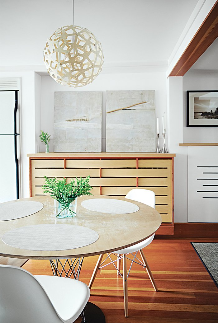 A Coral pendant lamp by David Trubridge hangs in the dining area.  Small Spaces by Caroly Haynes from Run-Down Row House in Boston Becomes a Quiet Urban Escape with Two Green Roofs