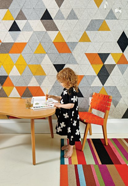 Chris Grimley and Kelly Smith transformed a cramped apartment into a family-friendly home. The room shared by Mae, three, and her little brother Roen, one, features a custom prototype mural by FilzFelt, their mother's textile design company. The carpet is by Flor, and the child-size chair and Amoeba table are both by Jens Risom for Knoll.