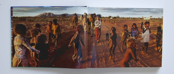 A spread from Inside Tracks featuring Smolan's photograph of Davidson in the Australian outback.