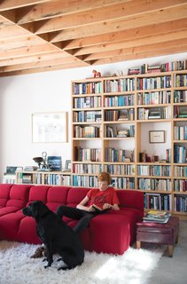 The Garage That's as Fun as the Living Room - Photo 1 of 4 - Wes Mahony lounges on a Tufty-Time sofa by Patricia Urquiola for B&B Italia in the family room that architect Emily Jagoda created for his family in their tree-damaged garage in Santa Monica.