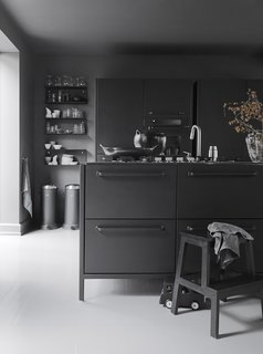 10 Stunning Ways to Use Black in Your Kitchen - Photo 5 of 10 - The iconic waste bin that gave Vipp its start is a mainstay in the Egelunds' home, as are many of the company's streamlined design solutions. The waste bins, shelves, glasses, and ceramics are by Vipp.