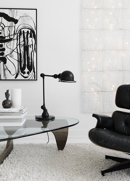 Sofie and her husband searched high and low for a vintage Herman Miller piece, finally finding a 30-year-old Eames lounge chair to complement the family's living room. The carpet is by Hay, the painting is by Claus Carstensen, and the lamp by Jielde.