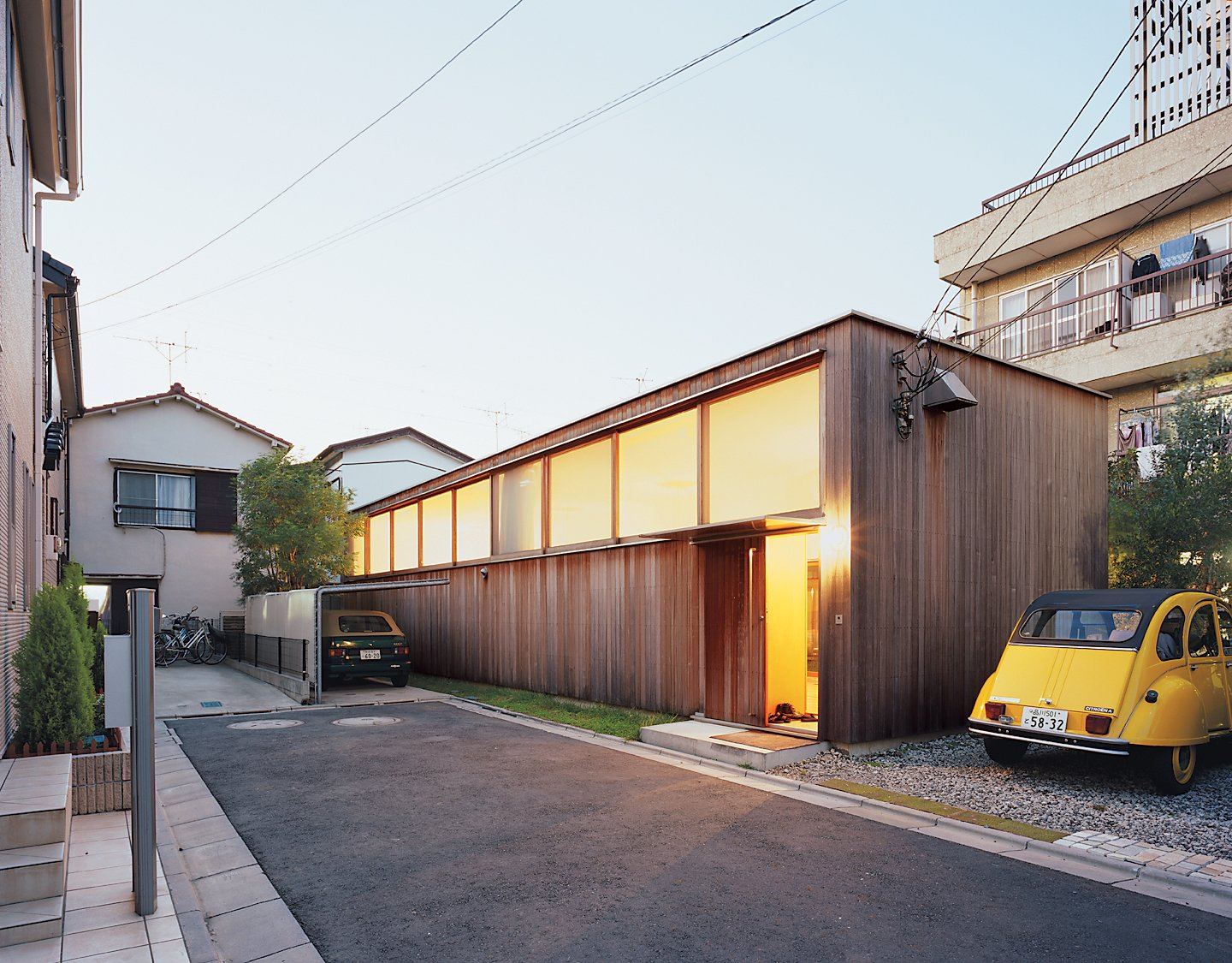 Large clerestory windows face the street at the Higashibatas' house in Tokyo, optimizing both privacy and natural light within.  Best by DAVE MORIN from Unique Tokyo-Based Architects