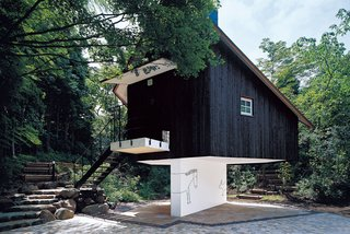 Terunobu Fujimori - Photo 4 of 23 - Fujimori has an affinity for building structures that appear to be perched precariously: His charred cedar-clad Guest House seems to balance on a sliver of a wall.