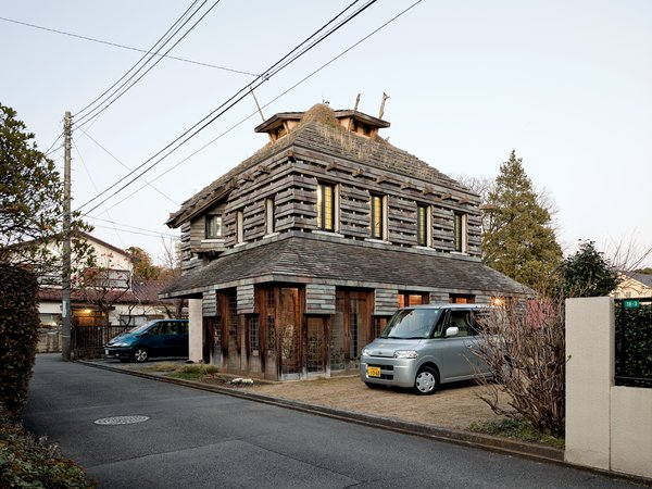 "Fujimori designed his own residence, the Tanpopo House, in 1995, with volcanic rock siding and grass and dandelions on the roof and walls; he is pleased by its ""bushy-haired expression."""
