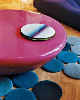 Like a Kid in a Candy Store - Photo 11 of 14 - The bright pink Smarties table by Mattia Bonetti is surounded by designs by the Bouroullec brothers—a lacquered steel table center and blue rug.