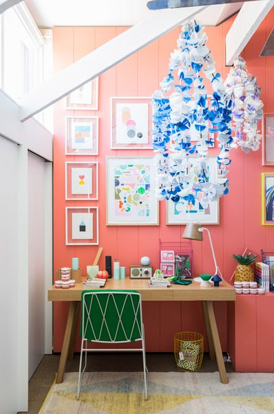 The kids' room designed by Lucy Feagins is especially vibrant, with Tango-painted walls by Delux, artwork by Rachel Castle and Beci Orpin, handmade beaded chandeliers by Emily Green, and a kicky pineapple lamp by Down to the Woods.