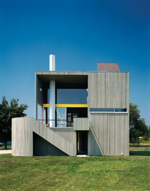 """The wood-frame residence and studio are clad in vertical cedar siding—back then, a daring competitor to clapboard—instead of concrete to save costs. The effect is equally seamless, however: """"If you drive by it fast enough,"""" Charles Gwathmey once said, """"you still might mistake it for a concrete house."""" Photo by Norman McGrath. Tagged: Exterior, Wood Siding Material, and House.  16 Funky Facades by Andrea Smith from Modern Hamptons Homes"""