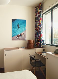Modern Home Furnished With Flea Market Finds - Photo 7 of 17 - The desk and cabinets in one bedroom are custom, and the chair is Patrick Norguet for Tolix.