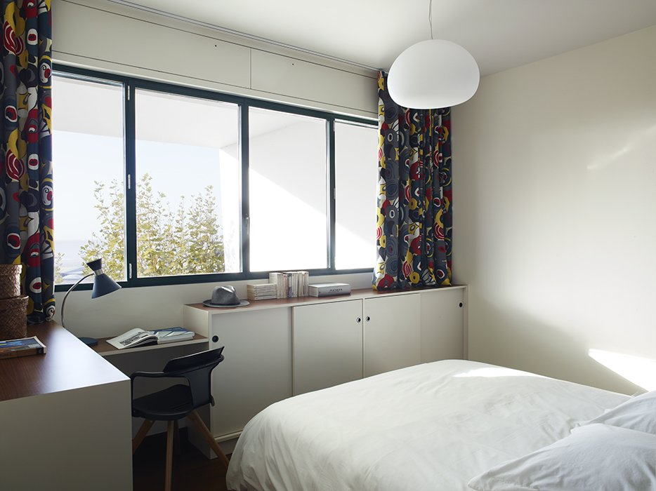 The curtains are made from graphic Gastón y Daniela fabrics.  Photo 8 of 17 in Modern Home Furnished With Flea Market Finds