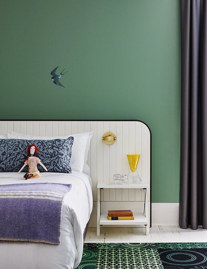 +tongtong custom designed the beds in the guestrooms; Multiflex fabricated them. The Monocle sconce from Rich Brilliant Willing offers light for nighttime reading.  Bedrooms by Dwell from Modern Boutique Hotel in a 19th-Century Foundry