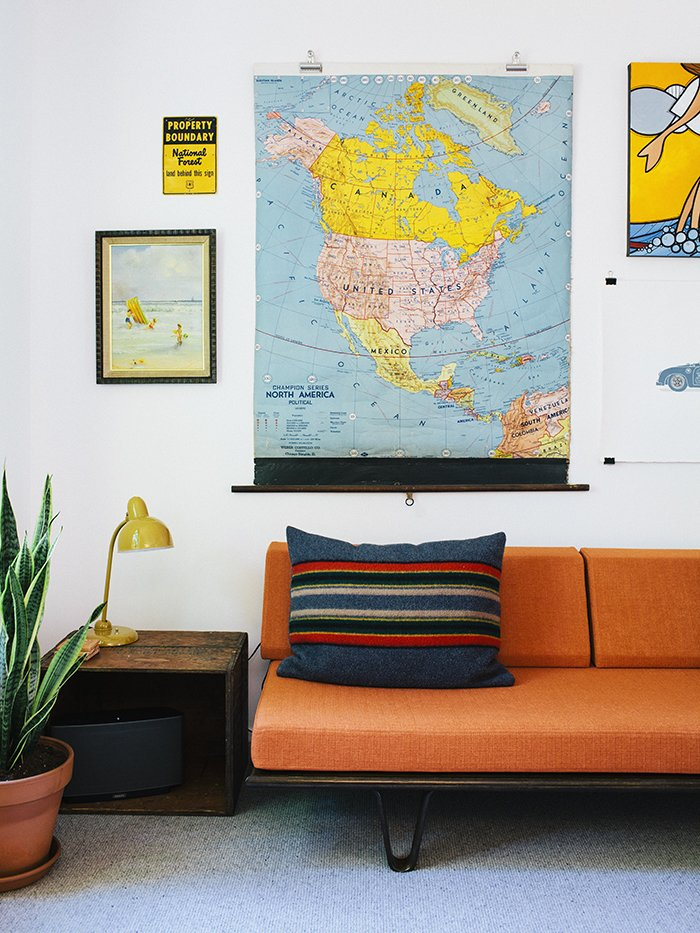The kids' room is outfitted with a cheerful orange Case Study daybed from Modernica and a selection of vintage maps and artwork. Midcentury Renovation in Portland Capitalizes on Nature with Seven Doors to the Outside - Photo 18 of 19