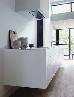 A Restless Real Estate Developer Builds His Ideal Live-Work Space - Photo 5 of 6 - The sleek, white kitchen is by Bulthaup.