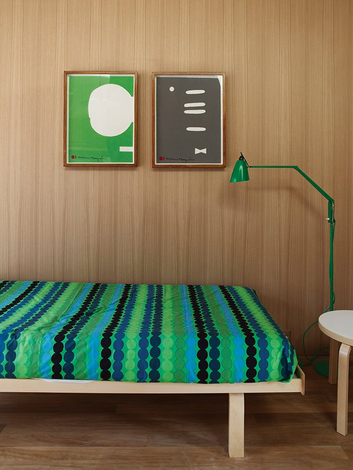 Räsymatto bedding by Marimekko in the studio is complemented by a green Anglepoise lamp from Sydney boutique Planet Furniture. Tagged: Bedroom, Bed, Medium Hardwood Floor, Night Stands, and Floor Lighting.  Photo 3 of 9 in Local Wood Clads Every Surface of This Idyllic Australian Getaway