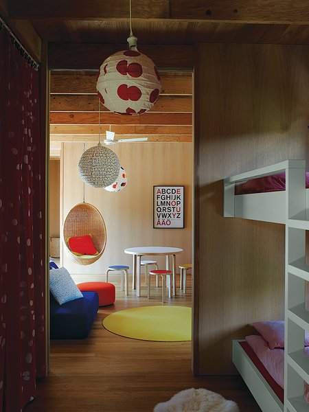 The couple's ten-year-old twins have connecting rooms next to a play space furnished with Aalto stools, a table from Artek, and a Nanna Ditzel rattan hanging chair purchased at Interstudio.