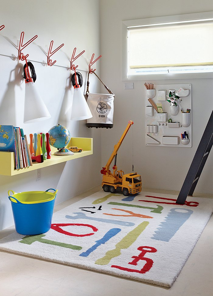 The boys' playroom is outfitted with a Uten.Silo wall organizer by Dorothee Becker for Vitra and a pair of May Day lamps by Konstantin Grcic for Flos that dangle from a set of Peace hooks by Louise Hederström for Maze.  Photo 4 of 9 in Smart Interior Update Shows When a Gut Renovation Isn't Necessary
