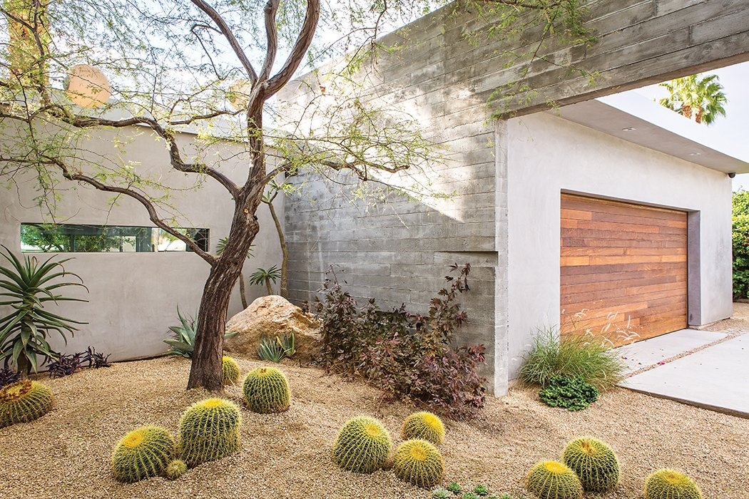 Lockyer added native desert plants to a courtyard near the garage. Tagged: Garage and Attached Garage.  47+ Midcentury Modern Homes Across America by Luke Hopping from Vacation Home in the California Desert is a Modernist Oasis