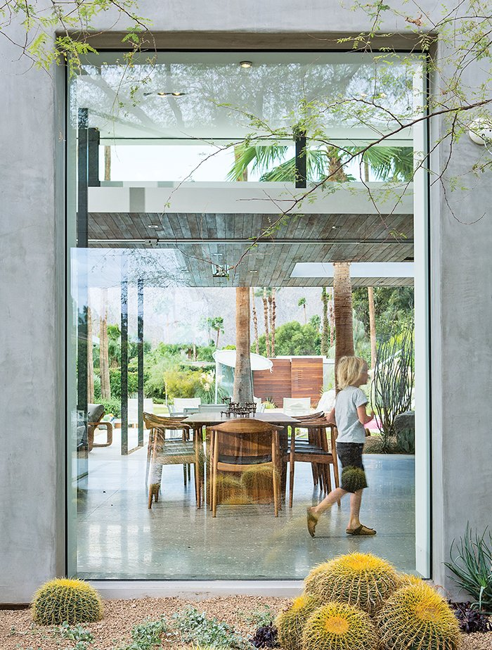 A floor-to-ceiling window frames the dining area.  Shining Examples of Clerestory Windows by Luke Hopping from Vacation Home in the California Desert is a Modernist Oasis