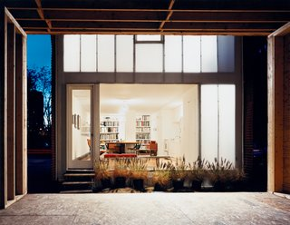 Now light emanates through the house's rear window, and through polycarbonate panels concealing the upstairs bedroom.