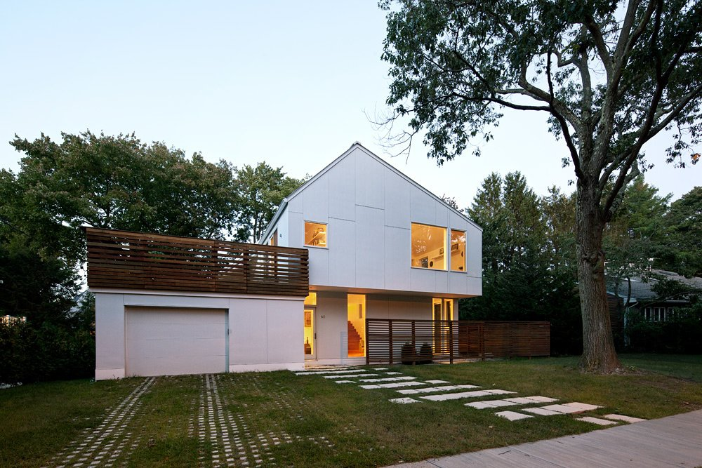 To maintain a sense of scale with regards to the lot, the Braver house was built up, down, and back. Through a series of split-levels, the previously one-story home is now three-and-a-half levels, with much of the new square footage reaching into the backyard.  The asymmetrical angle of the roof's pitch isn't architectural whimsy. Instead, it simultaneously hides an array of solar panels from view while optimizing its angle to the sun.