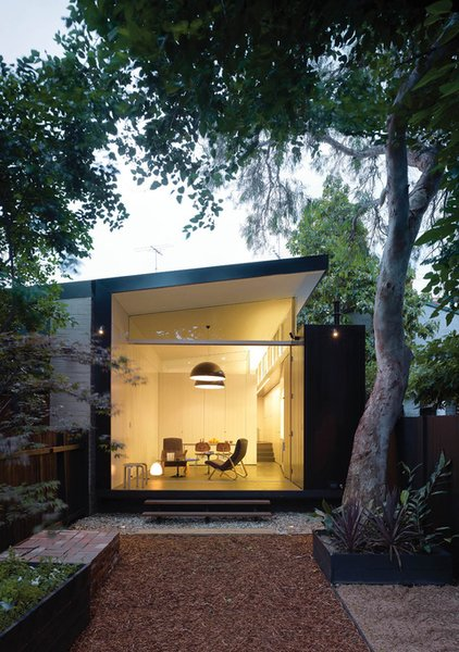 Though strict conservation regulations meant the front of this Newtown, Australia, home had to remain untouched, architect Christopher Polly had free reign to design a modern addition at the back of the house.