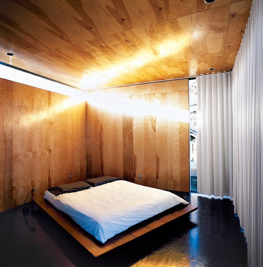 Thomas Bercy's austere bedroom. Tagged: Bedroom, Bed, and Dark Hardwood Floor.  Modern Bedroom Ideas  by Matthew Keeshin from Red, Wood, and Blue