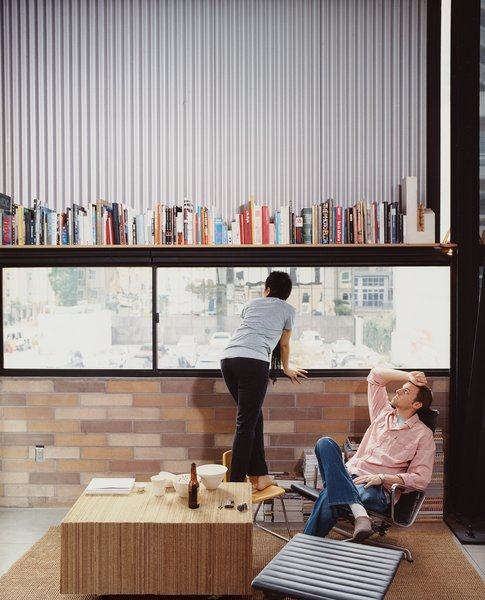 "The Schaffer's furniture includes an Eames Aluminum Group lounge chair (""and ottoman!"" adds Im.) A coffee table made of glued, corrugated cardboard was the couple's first project together, when they met in college eight years ago."