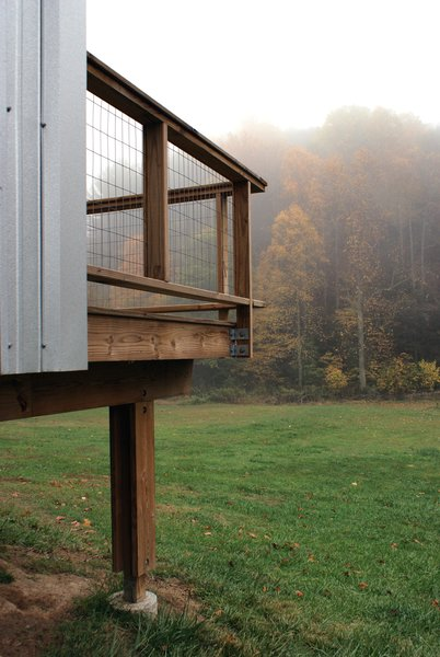An off-the-shelf post-and-beam system is used as foundation for the porches.  Welded wire mesh is used for the guardrail. Image courtesy Chad Everhart Architect.