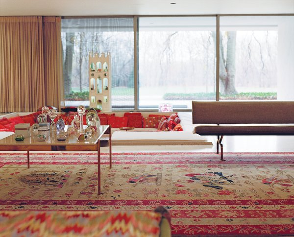 In the main living room, the pillows in the sunken seating area changed colors with the seasons: reds for the winter and lighter pastels for the warmer months. Photo 2 of Miller House in Columbus, Indiana by Eero Saarinen modern home