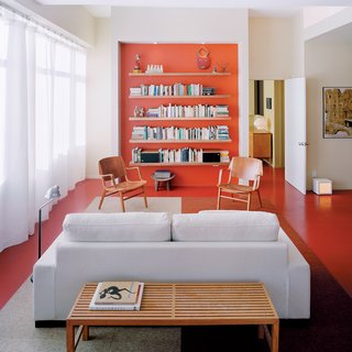 The Power of Color and What Each Shade Is Best For - Photo 7 of 11 - Architect Grant explains that the recessed orange wall with built-in storage shelving is a counterpoint to the view of Boston in the opposite direction.