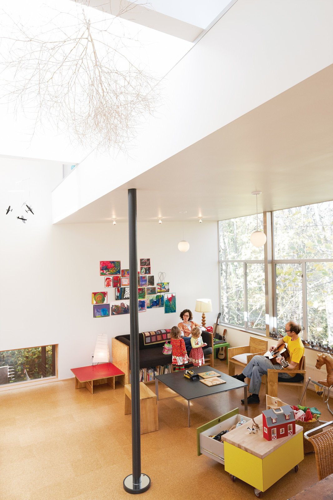 "The first-floor great room is where all the action takes place. ""It's like Frank Lloyd Wright's Usonian homes: everyone in one main space,"" Hale says.  Daring Hillside Homes by Diana Budds from A New Slant"