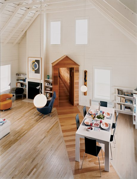 The great room's high, pitched roof and neutral walls give the space an open, tranquil feel, making it a desirable spot for the couple to pursue two of their passions: classical music and literature.