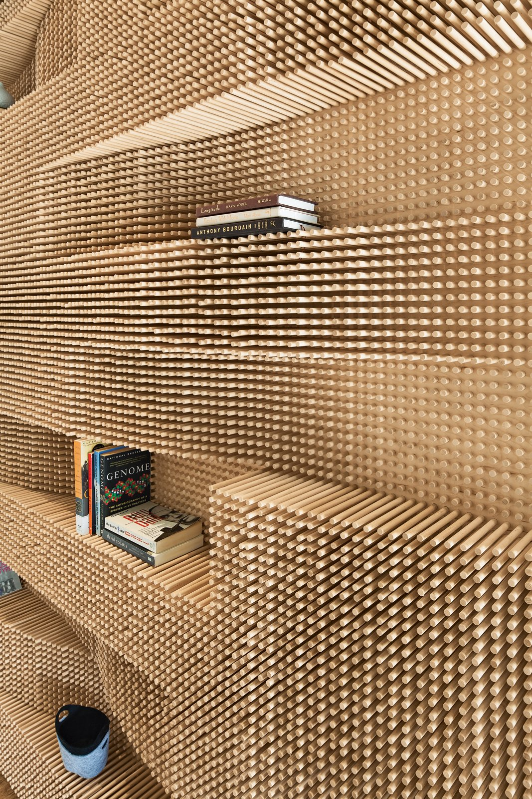 CATCH A WAVE  An undulating wall made from over 40,000 dowels adds a dose of awe to a Massachusetts loft.  photos by: John Horner