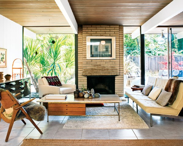 Modern Furniture Fit for a Classic Eichler - Photo 7 of 15 - In the living room, a travertine-topped coffee table by Paul McCobb pairs well with the Florence Knoll Parallel Bar System sofa. The Josef Albers print over the fireplace is an original, scored on eBay.