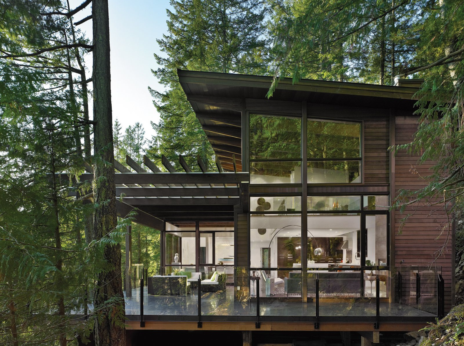 Photo by Patrick Barta Tagged: Large Patio, Porch, Deck, Exterior, House, and Wood Siding Material. Prefab by Arno Sandoval