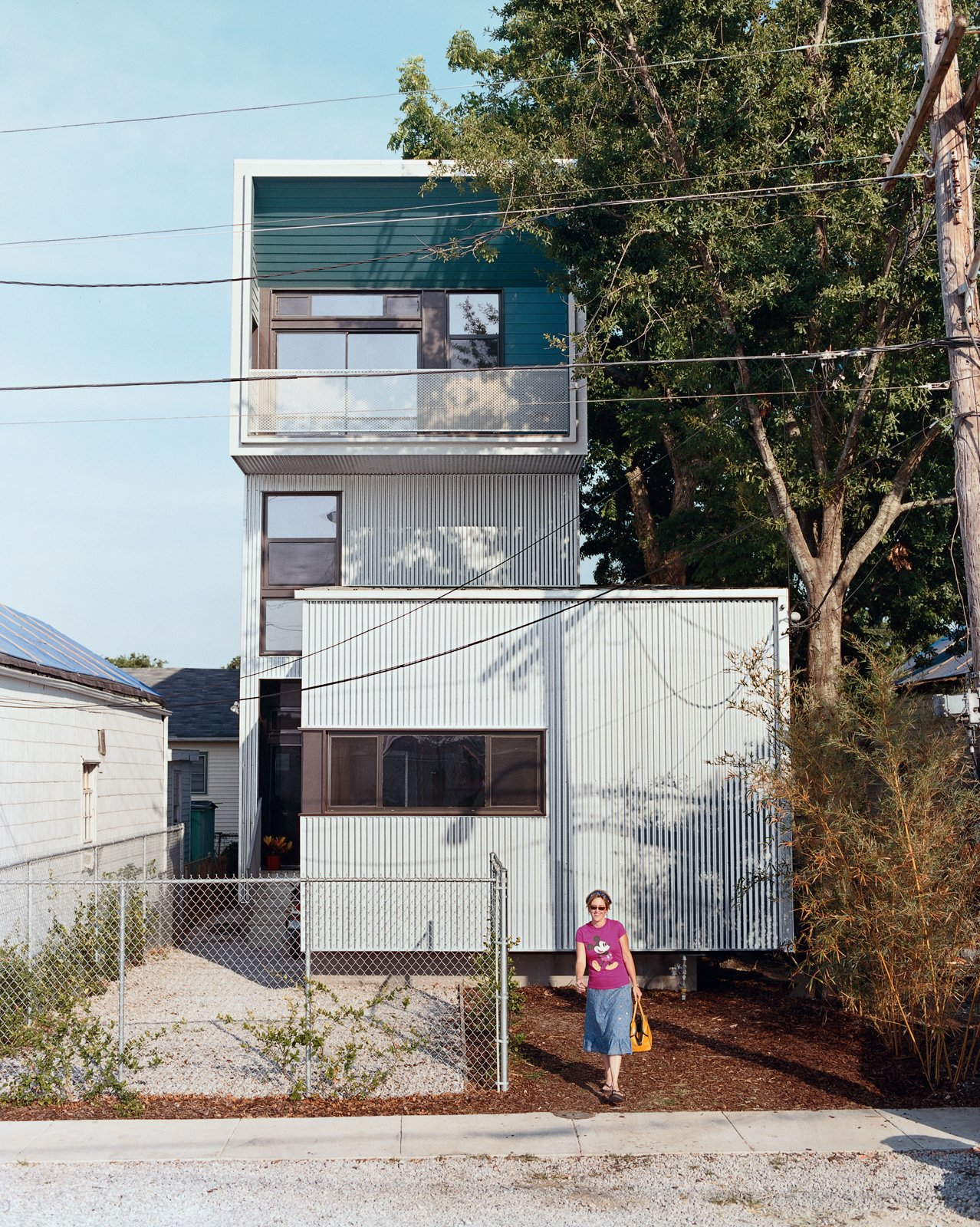 Julie Charvat of Bild Design exits the Lowerline House. Raised three feet off the ground—rather than slab on grade—the house is well equipped to battle any incoming flood waters.  Photo 2 of 11 in New Orleans, LA