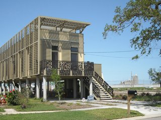 How Tiny and Prefab Homes Can Help People Recover After Natural Disasters - Photo 6 of 11 - As one of 150 prefab houses in New Orleans designed by architecture firm KieranTimberlake, the home is storm-resistant, affordable, and sustainable. Plus, it seeks to represent the traditional architecture of the area in a modern way.