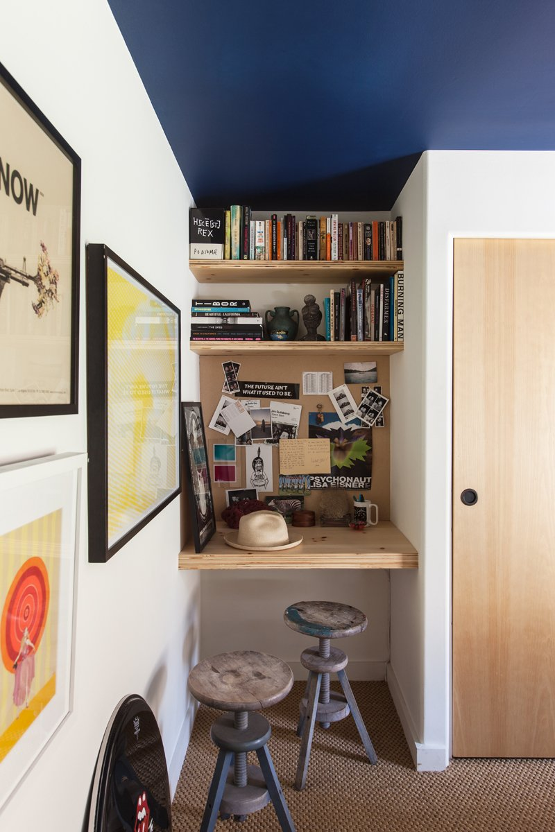 The bedroom allows for a tiny niche for a built-in wood desk. The target painting is by Alia Penner. A Modern Beachside Trailer Home in Malibu - Photo 6 of 7