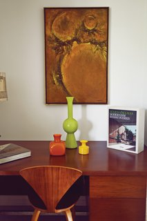 Tucked into one end of the house, a desk by Florence Knoll displays Stacey's mid-century pottery.