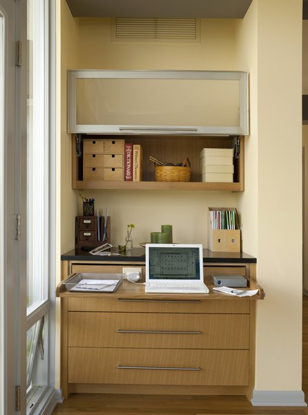 """The workstation, open. """"This was our solution to providing Karen with a place to work at home,"""" says Sundstrom. """"She used to work in the bedroom, but we cut the room down considerably, and we thought it would be best to keep the bedroom as a place to relax."""""""