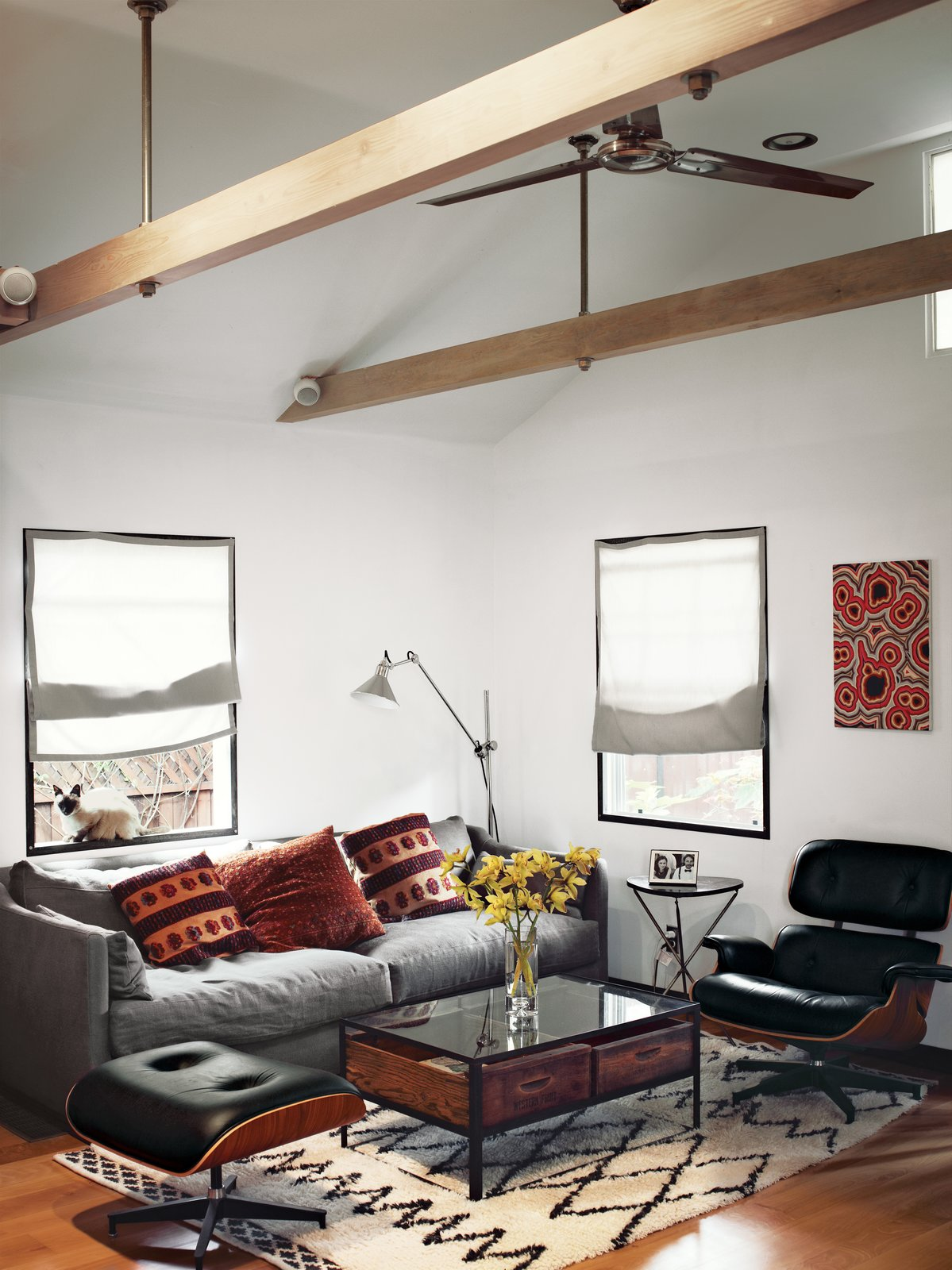 In the living area of actor Vincent Kartheiser's Hollywood cabin, redesigned by Funn Roberts to maximize every last inch of space, an Eames lounge chair and ottoman mix with a couch and coffee table by Cisco Home from HD Buttercup. The table in the main room is from West Elm. Tagged: Living Room, Recliner, Sofa, Coffee Tables, and Medium Hardwood Floor.  Loft by Tremaine Eppenger from The Tiny Hollywood Home of Mad Men's Vincent Kartheiser