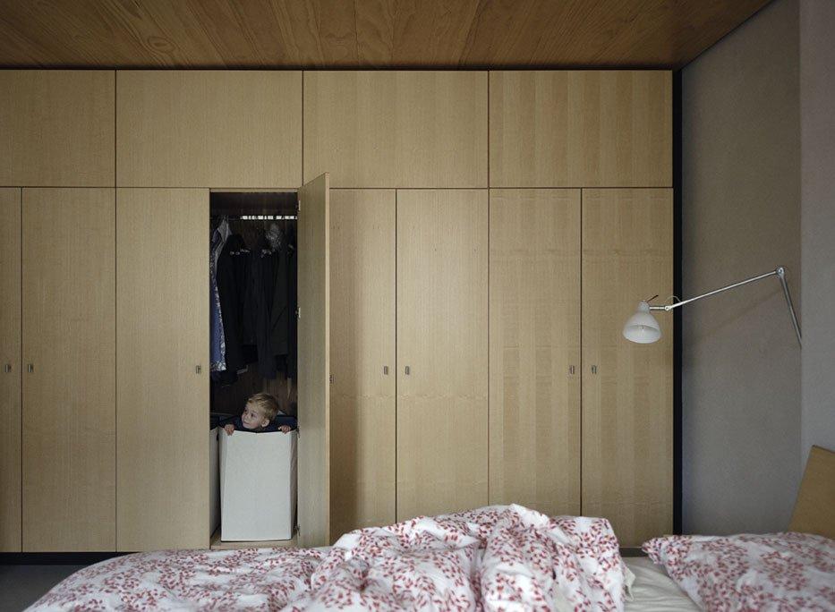 Paul finds a hiding place amongst the bedroom built-ins.